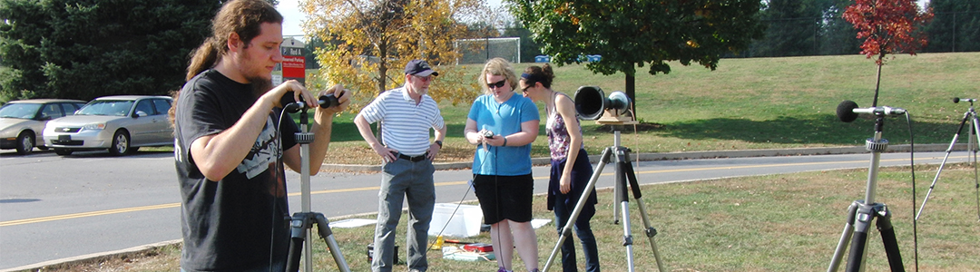Students setup mics and take outdoor noise measurements.